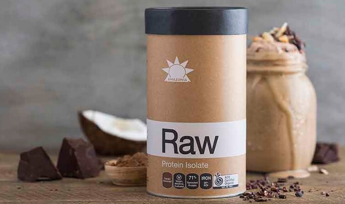 raw protein isolate tub next to raw ingredients