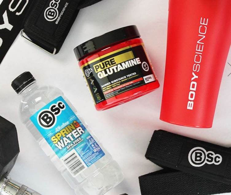 glutamine surrounded by gym accessories