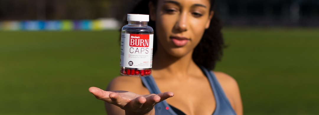 woman holding a bottle of maxines burn caps