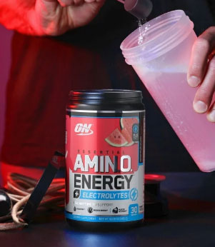 person scooping optimum nutrition essential amino energy plus electrolytes into a shaker