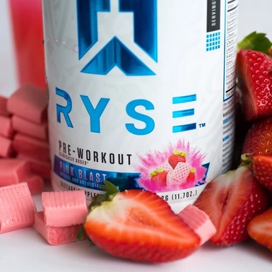 Ryse Pre-workout surrounded by fresh fruit