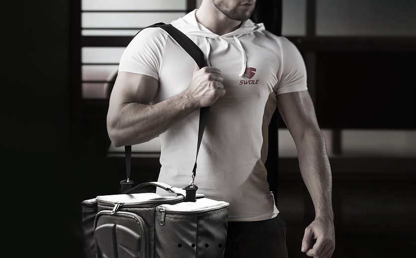 Fit Man With Swole bag over shoulder